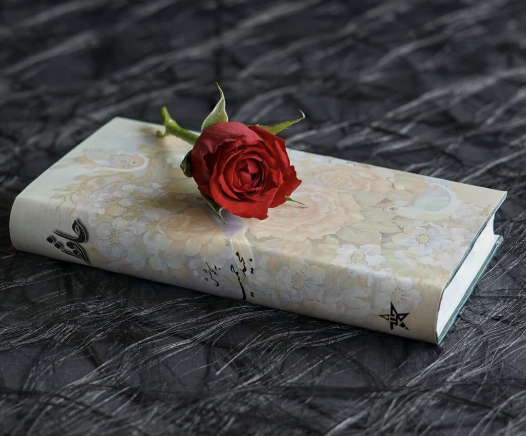 Charlatan left a book and a rose